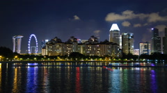 Time lapse city night view Singapore flyer and Marina Bay Stock Footage