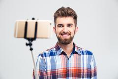 Portrait of a cheerful young man making selfie photo Stock Photos