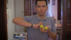 Young Asian man throws bananas out of his hand Stock Footage