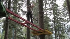 Young girl having fun in a climbing adventure Stock Footage