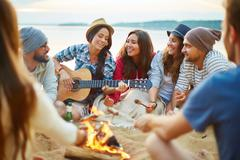 Campfire singing - stock photo