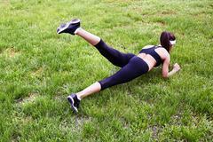 Exercising on lawn - stock photo