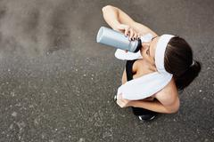 Refreshing after workout - stock photo