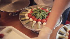 Stock Video Footage of Cooks put vegetables on trays for catering