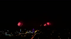 A beautiful pyro show fireworks in the big city in the night sky and buildings. Stock Footage