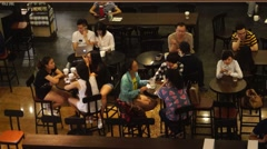 City white collar men and women in the coffee shop to drink coffee - stock footage