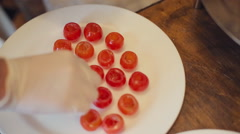 Stock Video Footage of Cook prepares cherry tomatoes to stuffing in a restaurant
