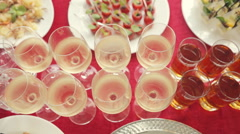 Row of the glasses with alcohol and juice, a wide variety of snacks at the Stock Footage