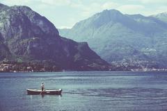 Lake and fisherman - stock photo