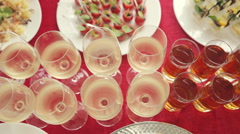 Row of glasses of alcohol and juice, a wide variety of snacks at the banquet Stock Footage