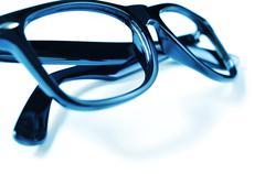 black plastic rimmed eyeglasses - stock photo
