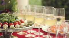 Vegetables on a tray and alcohol poured into glasses at a banquet Stock Footage