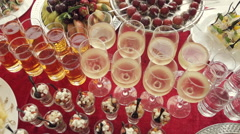 Alcohol in the glasses, juice, salads, canapés and fruit for catering Stock Footage