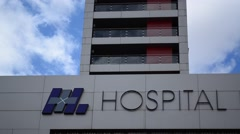 Health care Hospital sign with blue sky and clouds - stock footage