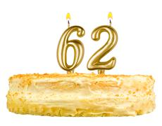 birthday cake with candles number sixty two - stock photo