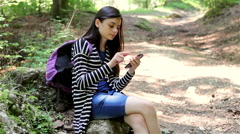 Teenager girl tourist using smartphone Stock Footage