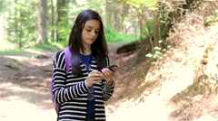Young girl tourist using smartphone Stock Footage