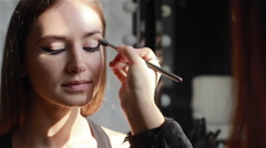 Professional eyeshadow application using a brush. Close-up - stock footage