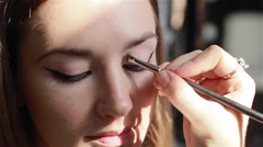 Professional eye make-up: eyeshadow application. Close-up Stock Footage