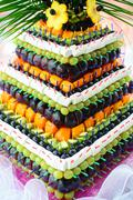 Pyramid with fresh fruits on the wedding banquet Stock Photos