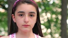 Sad child girl looking at camera close up - stock footage