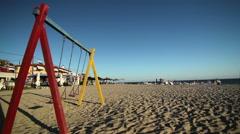 Swing set on a beach Stock Footage