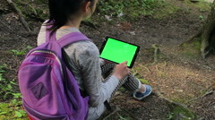 Teenage girl using tablet pc with green screen 2 Stock Footage