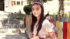 Young schoolgirl back to school - stock footage