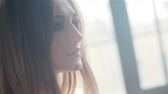 The side view of pretty women in sunlight. Close-up Stock Footage