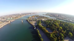 Aerial view over St Helen's Island, Jacques Cartier Bridge on St Lawrence River - stock footage