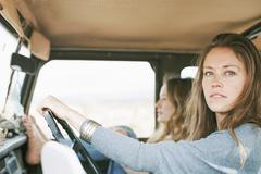 Two women on an outing in the desert, in a 4x4. - stock photo
