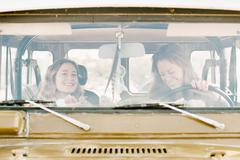 Two women on an outing in the desert, driving in a 4x4. - stock photo