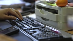 Typing on a computer keyboard - stock footage