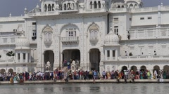 Sikhs and indian people visiting the Golden Temple in Amritsar, Punjab, India. - stock footage