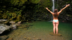Attractive Girl Under Waterfall - stock footage