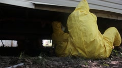 Removing Wet Insulation from Underneath Mobile Home - stock footage