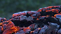 Beautiful log smoldering in the fire Stock Photos