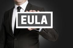 Eula sign is held by businessman - stock photo
