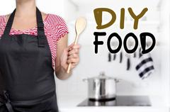 Diy food cook holding wooden spoon background Stock Photos