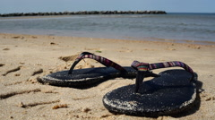 Sandals on the beach Stock Footage