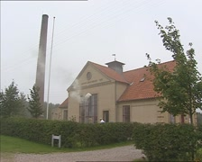 Stock Video Footage of front historic diary co-opererative in operation. NYVANG, DENMARK