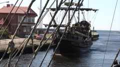 Stock Video Footage of Replica of a historic sailing ship with tourists enters a port in Darlowo.