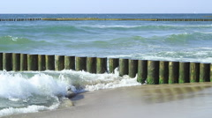Wooden breakwaters protecting the Baltic sea coast Stock Footage