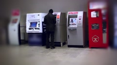 Suspicious Man tourist puts bank card into the ATM Stock Footage