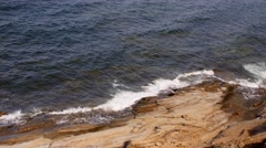 Rough waves crash on rocky shore from above Stock Footage