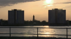 Setting Sun Tower Blocks Gosport Across Portsmouth Harbour Entrance in Hampsh Stock Footage