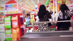 Women shopping at the supermarket Stock Footage