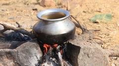 Metal pot with food on fire, Pushkar, India. Close up, outdoors - stock footage