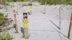Sea turtle nesting site and warning sign in Florida Stock Footage