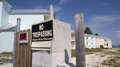 A No Trespassing sign posted at the entrance to a foreclosed condo development. Stock Footage